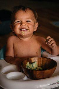 boy enjoying food in its natural form