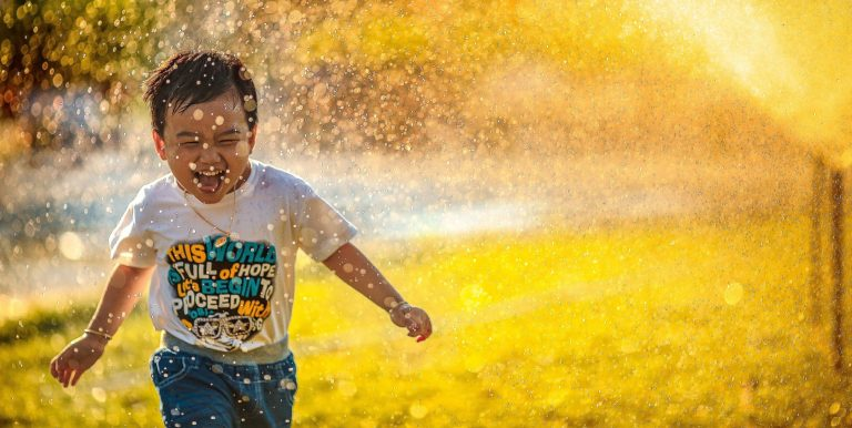 boy running free in happiness