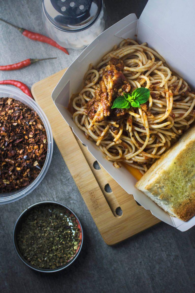 spaghetti packed in takeaway box